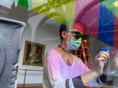 Clara Wang installs colorful cellophane squares to large glass panels